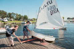Two children launching sailboat in Kaunas Stock Images