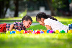 Two children are laying on green grass Royalty Free Stock Photo