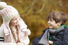 Two Children Leaning Over Wooden Fence Talking Stock Images
