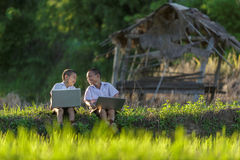 Two children learn the Internet. stock photography