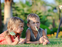 Two children with lollipops Royalty Free Stock Photo