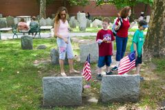 Two children look at Revolutionary Graves Royalty Free Stock Image