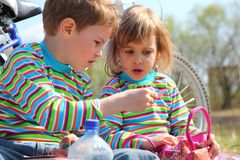 Two children look at something outdoor Royalty Free Stock Photography
