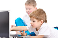 Two children looking on laptop screen royalty free stock photography