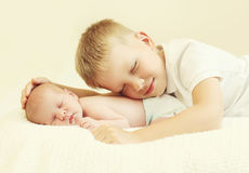Two children lying sleeping on the bed at home Royalty Free Stock Photography