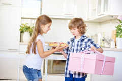 Two children on mother's day with gift and cake Stock Images