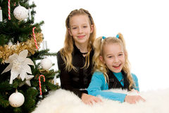 Two children near christmas tree Royalty Free Stock Photo