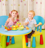 Two children paint Easter eggs Royalty Free Stock Photography