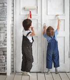 Two children paint indoors Royalty Free Stock Photo