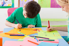 Two children paint markers Stock Photos