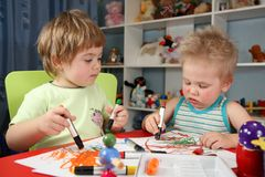 Two children painting Stock Photo
