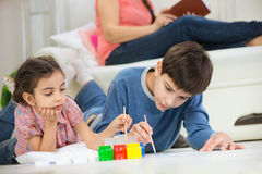 Two children painting with colorful paints at home Royalty Free Stock Photo