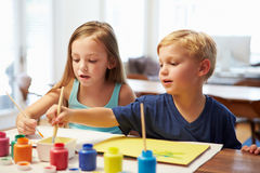 Two Children Painting Picture At Home Royalty Free Stock Image