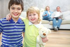 Two children and parents Stock Images