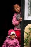 Two children peeping Stock Image