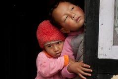 Two children peeping Royalty Free Stock Image