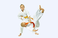 Two children performs judo throws. On the light background Stock Images