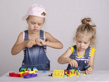 Two children play in the constructor Stock Images