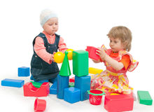 Two children play cubes Stock Image