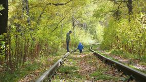 Two children play on the empty rail stock video