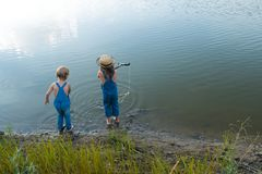 Two children play near the river royalty free stock photos