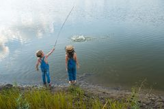 Two children play near the river royalty free stock image