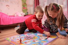 Two children play in playroom Stock Images