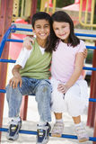 Two children in playground Royalty Free Stock Images