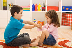 Two children playing Stock Images
