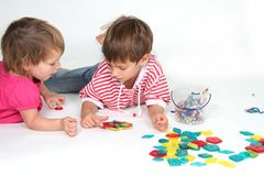 Two children playing Royalty Free Stock Image