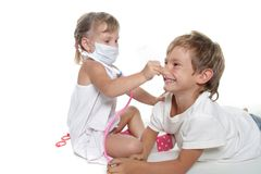 Two children playing as doctor and patient Royalty Free Stock Image