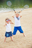 Two children playing with badminton equipment Royalty Free Stock Photos
