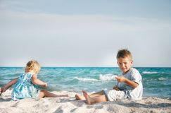 Two children playing on beach Royalty Free Stock Images