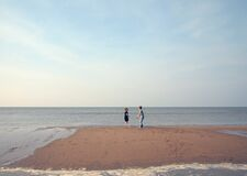 Two Children Playing on a Beach Royalty Free Stock Images