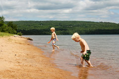 Two Children PLaying on Beach at Lake Superior Stock Photography