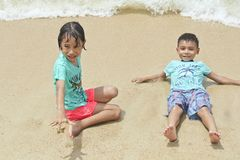 Two children playing on the beach in thailand royalty free stock photography