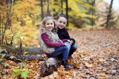 Children playing in beautiful autumn park on cold sunny fall day. royalty free stock photography