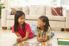 Two Children Playing Board Game At Home stock photos