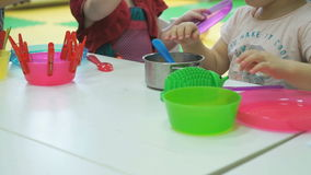 Two children playing with children's tableware stock footage