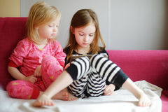 Two children playing with a digital tablet at home Royalty Free Stock Photography