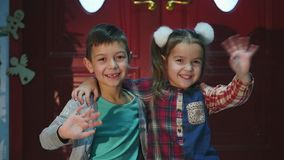 Two children playing with each other. New Year. Christmas stock video