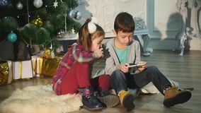 Two children playing with each other. New Year. Christmas stock video footage