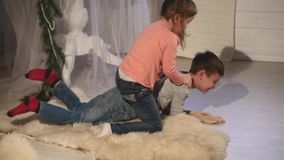 Two children playing with each other. New Year. Christmas stock footage