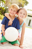 Two Children Playing Game Of Volleyball In Garden Royalty Free Stock Photos
