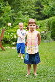Two children playing in garden Royalty Free Stock Photography