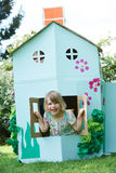 Two Children Playing In Home Made Cardboard House Stock Images