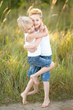 Two children playing on meadow Stock Image