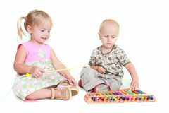 Two children playing music piano Royalty Free Stock Photo