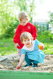 Two children playing with sand Royalty Free Stock Photos