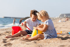 Two children   playing with sand Stock Photo